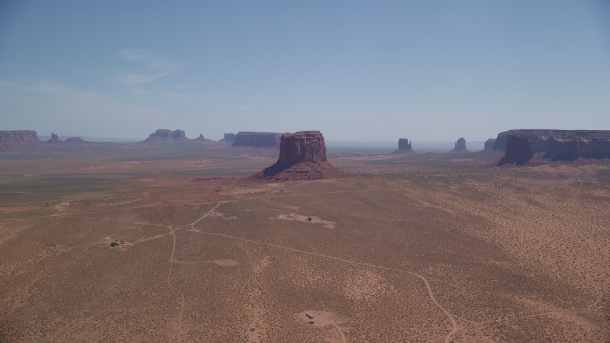 6K stock footage aerial video of a wide view of open desert, mesas and buttes, Monument Valley, Arizona, Utah Aerial Stock Footage | AX135_194