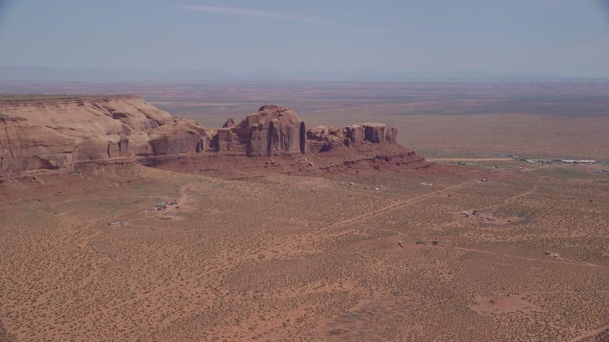 Flying by Rock Door Mesa, town of Goulding, Navajo Nation Reservation, Utah, Arizona Aerial Stock Footage | AX135_196