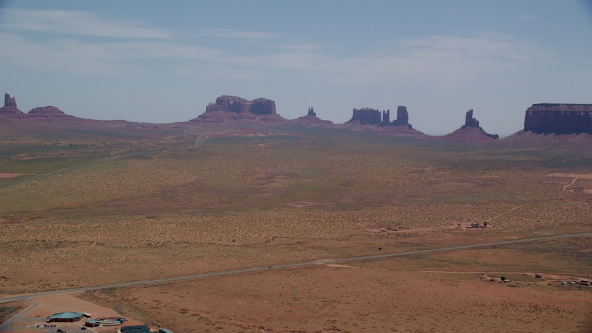 Flying by highway, buttes, Monument Valley Road, Monument Valley Arizona, Utah Aerial Stock Footage | AX136_003