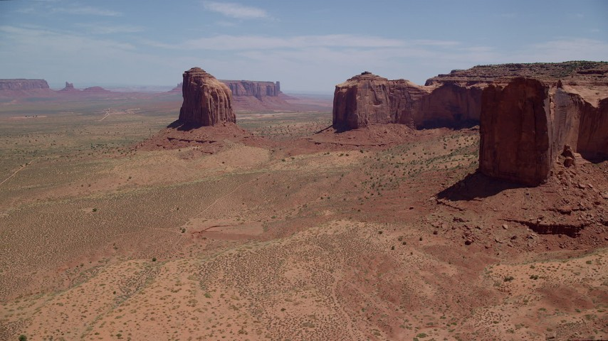 6K stock footage aerial video of flying by Gray Whiskers Butte, Mitchell Mesa, Monument Valley, Utah, Arizona Aerial Stock Footage | AX136_011