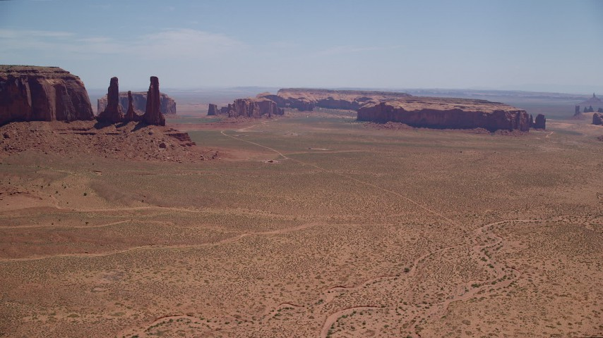 6K stock footage aerial video flyby buttes and mesas, revealing Elephant Butte in Monument Valley, Utah, Arizona Aerial Stock Footage | AX136_015