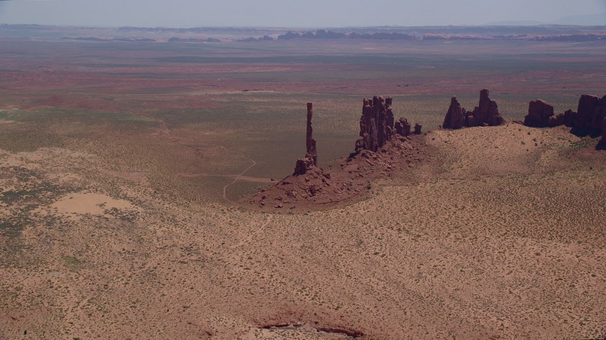 6K stock footage aerial video of flying toward Totem Pole Butte, Yei Bi Chei Butte in Monument Valley, Utah, Arizona Aerial Stock Footage | AX136_022