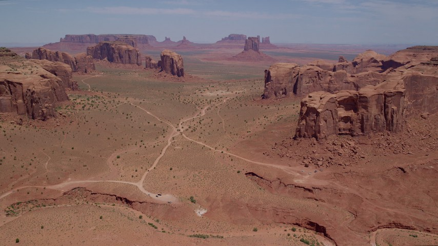 Approaching buttes and mesas, Monument Valley, Utah, Arizona Aerial Stock Footage | AX136_023