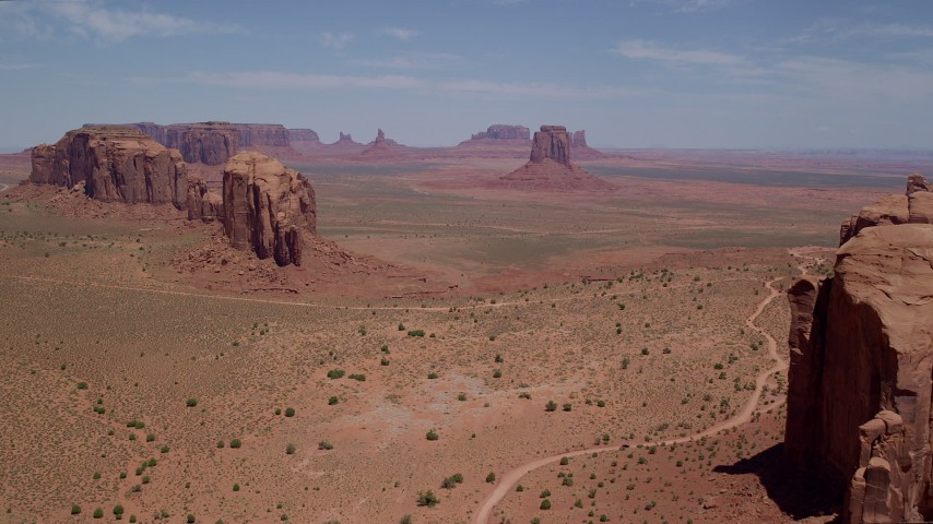 6K stock footage aerial video of flying toward East Mitten Butte in Monument Valley, Utah, Arizona Aerial Stock Footage | AX136_025