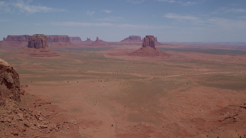 Approaching East Mitten Butte, Monument Valley, Utah, Arizona Aerial Stock Footage | AX136_026