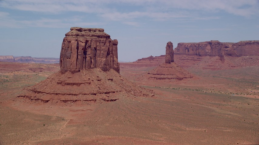 Flying by Merrick Butte, West Mitten Butte, Monument Valley, Utah, Arizona Aerial Stock Footage | AX136_029