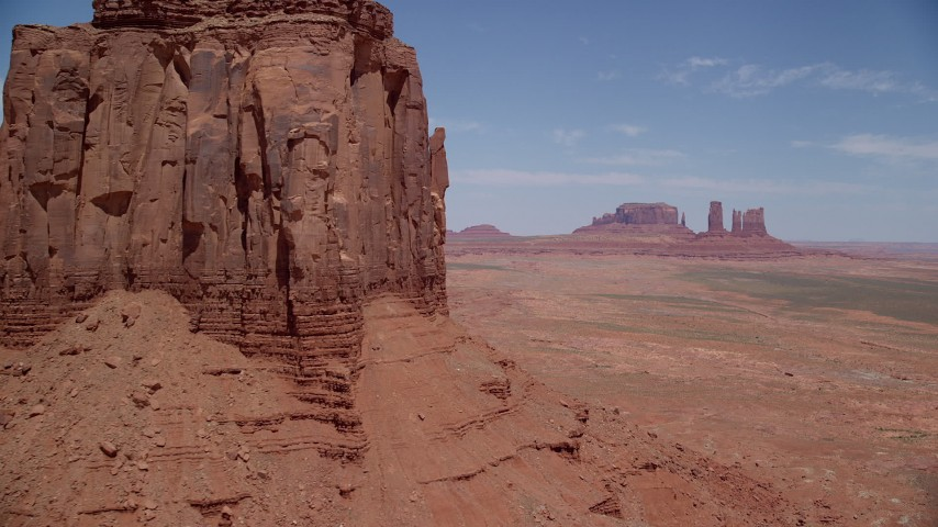 Approaching East Mitten Butte, reveal Sentinel Mesa, Monument Valley, Utah, Arizona Aerial Stock Footage AX136_031