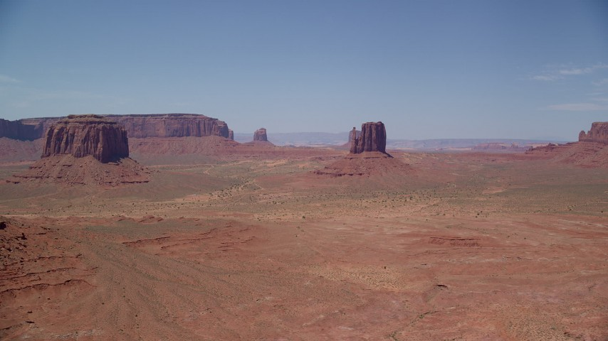 6K stock footage aerial video of a wide view of a few desert buttes and mesas, Monument Valley, Utah, Arizona Aerial Stock Footage | AX136_033