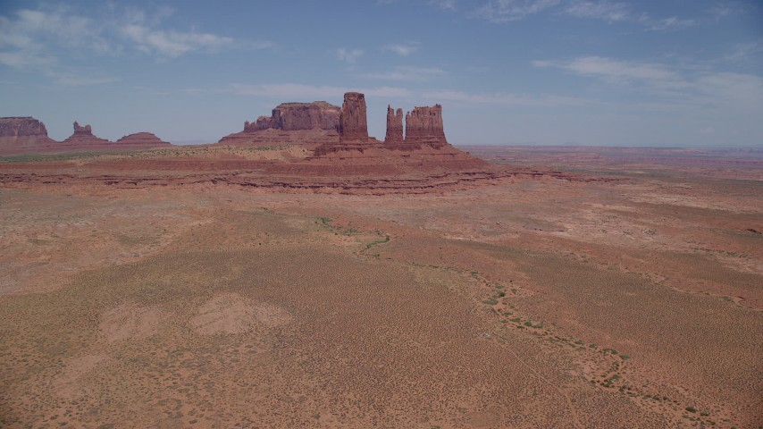 6K stock footage aerial video of approaching jagged desert buttes in Monument Valley, Utah, Arizona Aerial Stock Footage | AX136_034
