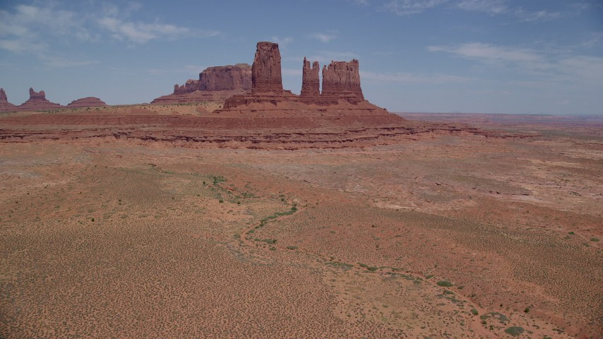 Approaching desert buttes, Monument Valley, Utah, Arizona Aerial Stock Footage | AX136_035