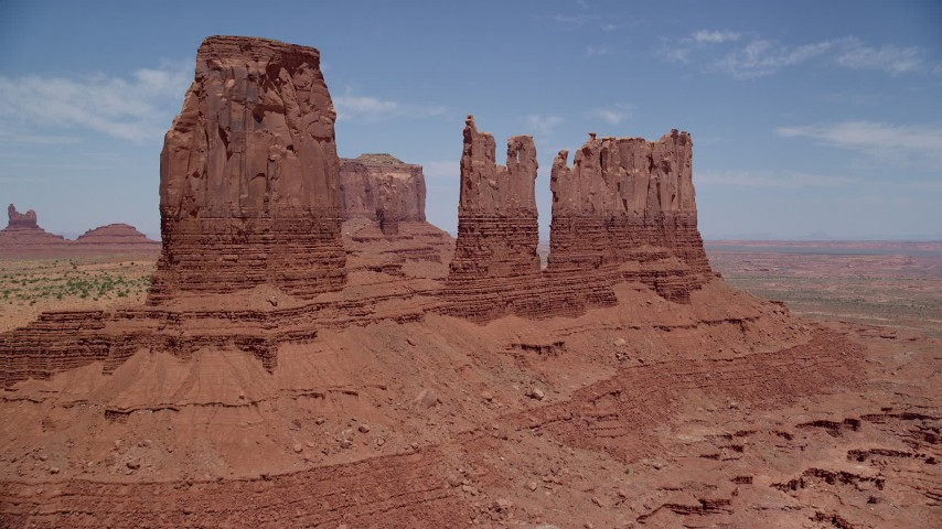 Approaching desert buttes, Monument Valley, Utah, Arizona Aerial Stock Footage | AX136_037