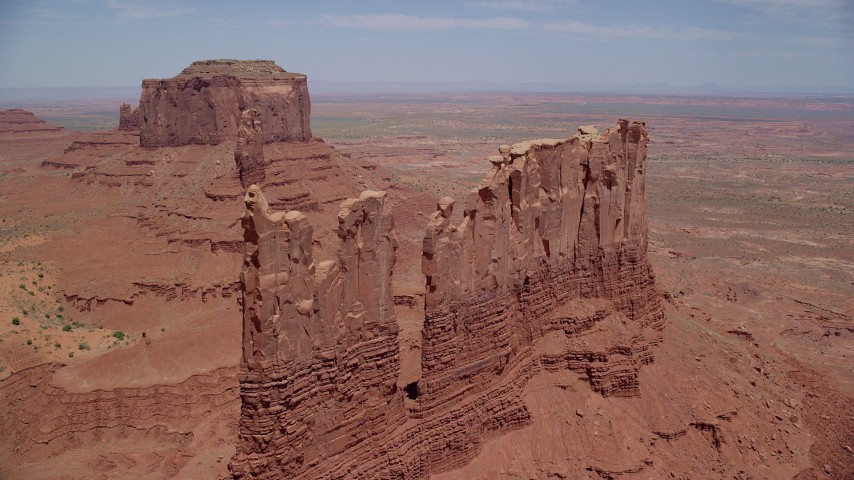 6K stock footage aerial video of approaching tops of desert buttes,  Monument Valley, Utah, Arizona