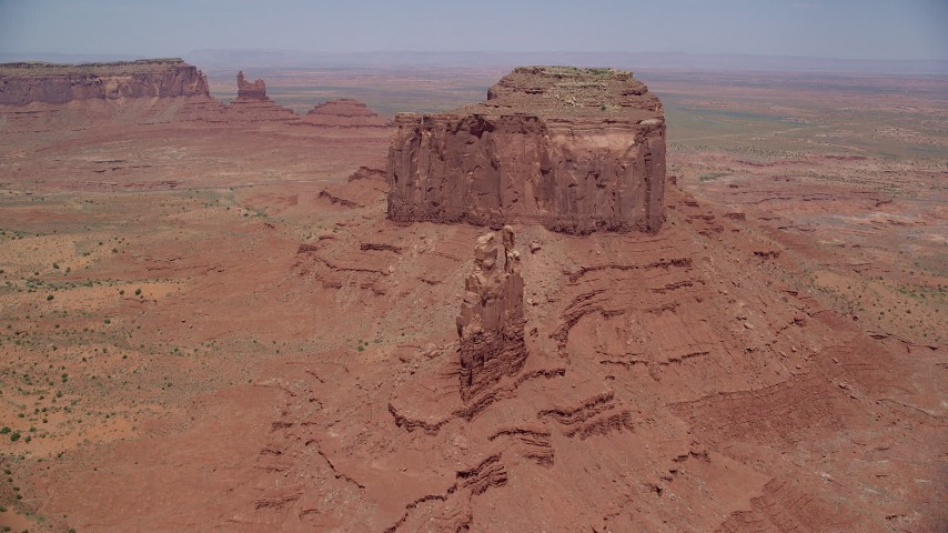 Approaching desert buttes, Monument Valley, Utah, Arizona Aerial Stock Footage | AX136_040