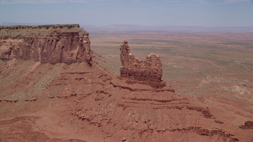 6K stock footage aerial video of approaching and flying over Setting Hen Butte, Monument Valley, Utah, Arizona Aerial Stock Footage | AX136_043