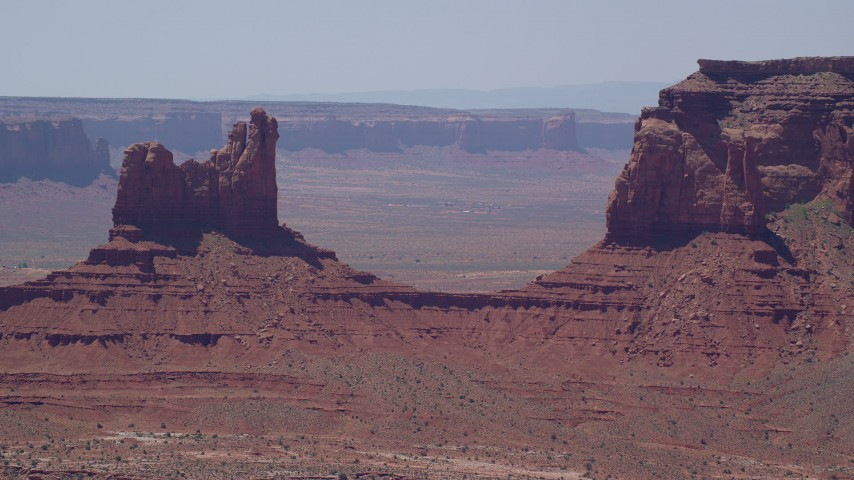 6K stock footage aerial video of flying away from Setting Hen Butte in Monument Valley, Utah, Arizona Aerial Stock Footage | AX136_045