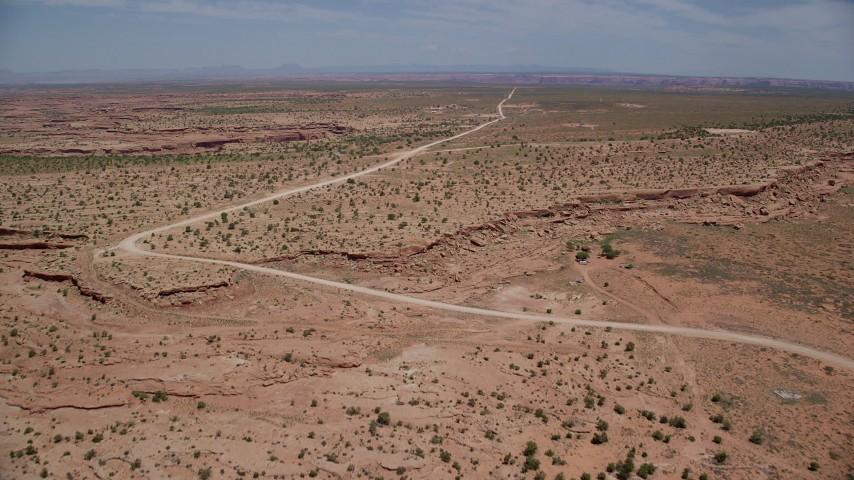 6K stock footage aerial video of approaching Douglas Mesa Road, Navajo Nation Reservation, Utah, Arizona Aerial Stock Footage | AX136_049