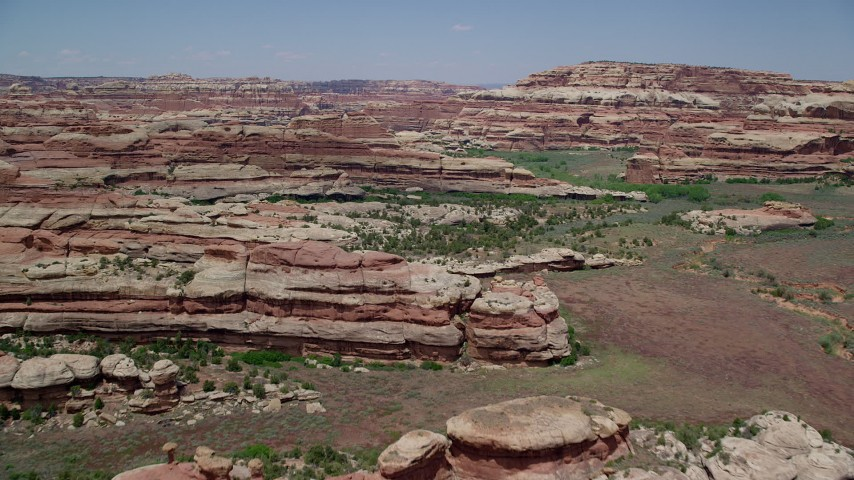 Flying over narrow valley, rock formations, Canyonlands National Park, Utah Aerial Stock Footage | AX136_206