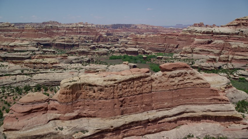 6K stock footage aerial video of tall desert rock formations in Canyonlands National Park, Utah Aerial Stock Footage | AX136_208