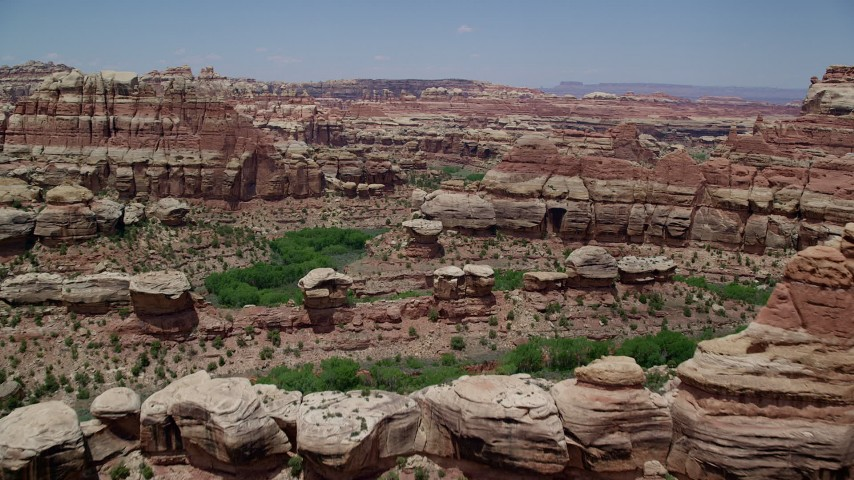 6K stock footage aerial video of flying over rock formations and canyons, Canyonlands National Park, Utah Aerial Stock Footage | AX136_210