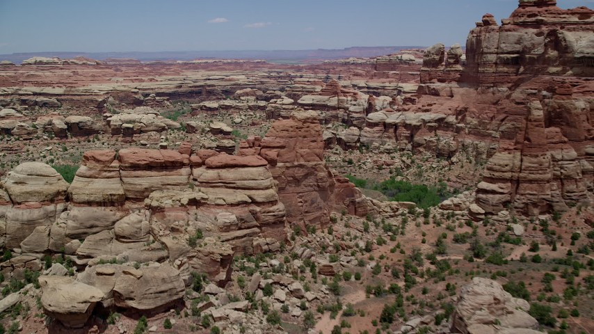 6K stock footage aerial video of flying over rock formations, boulders and canyons, Canyonlands National Park, Utah Aerial Stock Footage | AX136_211