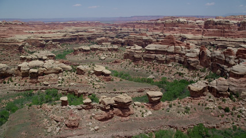 6K stock footage aerial video of flying over boulders, rock formations and canyons, Canyonlands National Park, Utah Aerial Stock Footage | AX136_212