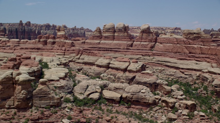 6K stock footage aerial video of flying by canyons between rock formations, Canyonlands National Park, Utah Aerial Stock Footage | AX136_213