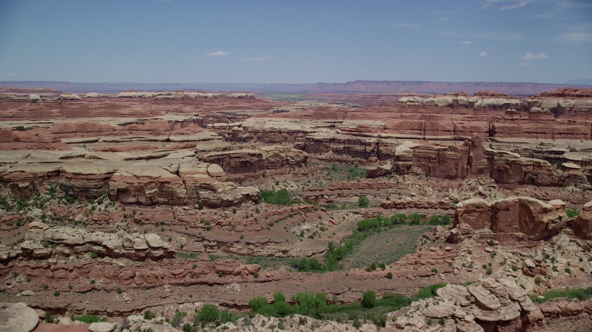 6K stock footage aerial video fly over canyons between rock formations, Canyonlands National Park, Utah Aerial Stock Footage | AX136_216