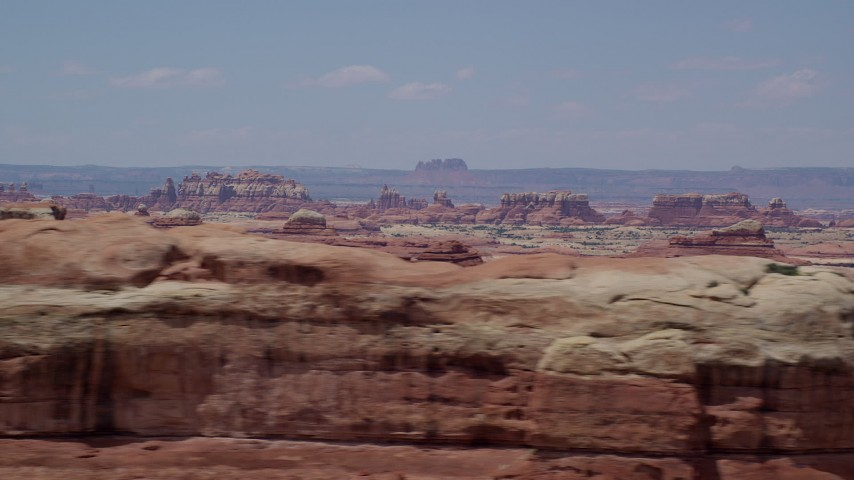 6K stock footage aerial video of a wide view of rows of desert rock formations, Canyonlands National Park, Utah Aerial Stock Footage | AX136_219