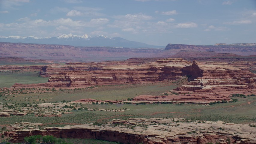 6K stock footage aerial video of desert rock formations and green valleys, Canyonlands National Park, Utah Aerial Stock Footage | AX136_223