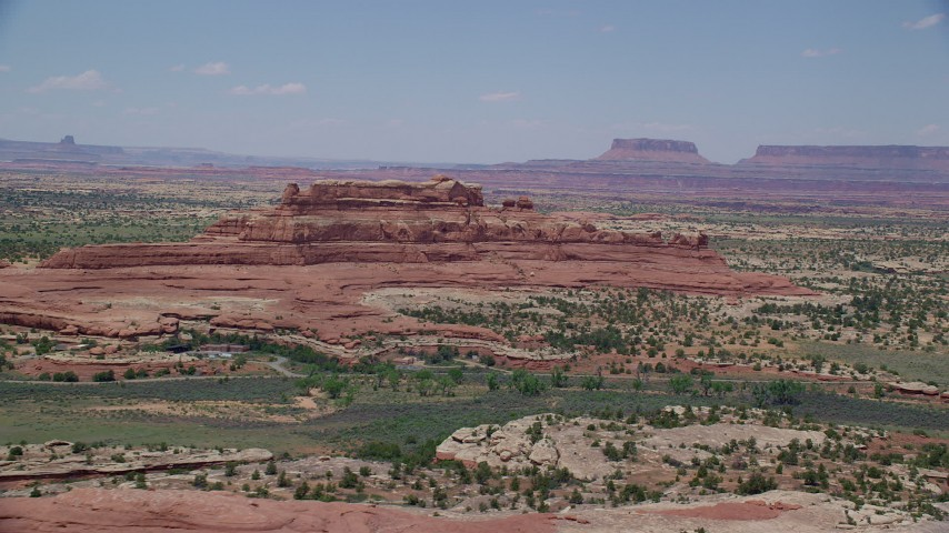 6K stock footage aerial video of flying by Squaw Butte at Canyonlands National Park, Utah Aerial Stock Footage | AX136_224