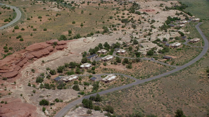 Flying by rural homes, Residence Road, Canyonlands National Park, Utah Aerial Stock Footage | AX136_226
