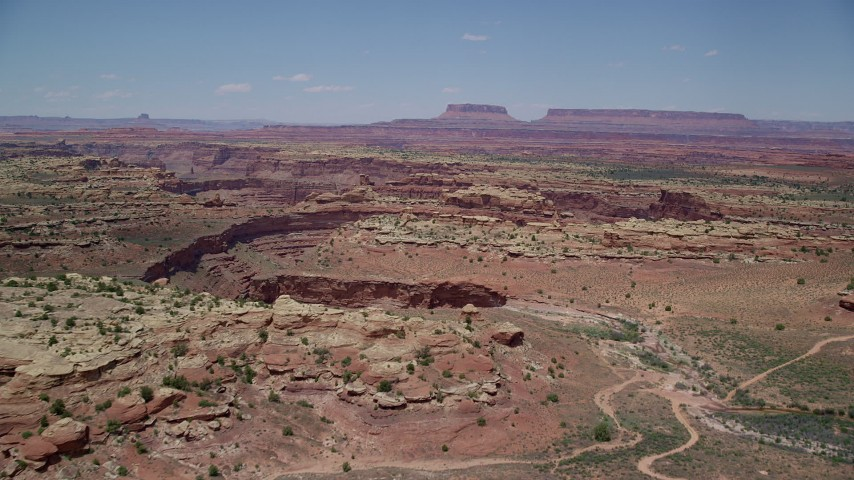 6K stock footage aerial video of approaching rock formations and Big Spring Canyon, Canyonlands National Park, Utah Aerial Stock Footage | AX136_229
