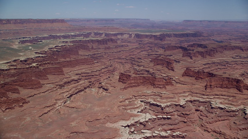 Approach buttes, canyons, near White Rim cliffs, Canyonlands National Park, Utah Aerial Stock Footage | AX136_246