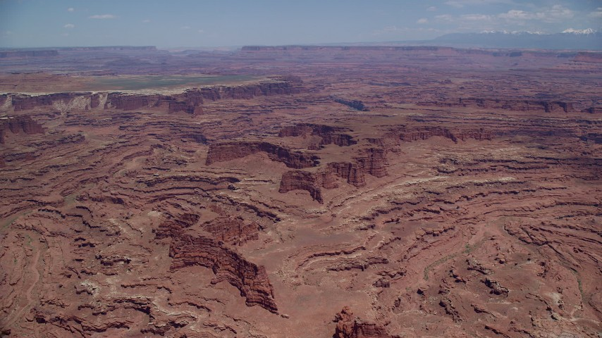 6K stock footage aerial video pan across and approach canyons, buttes near White Rim cliffs, Canyonlands National Park, Utah Aerial Stock Footage | AX136_247