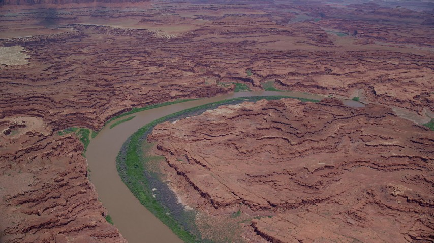 6K stock footage aerial video of flying over Colorado River, approaching canyons, Canyonlands National Park, Utah Aerial Stock Footage | AX136_257