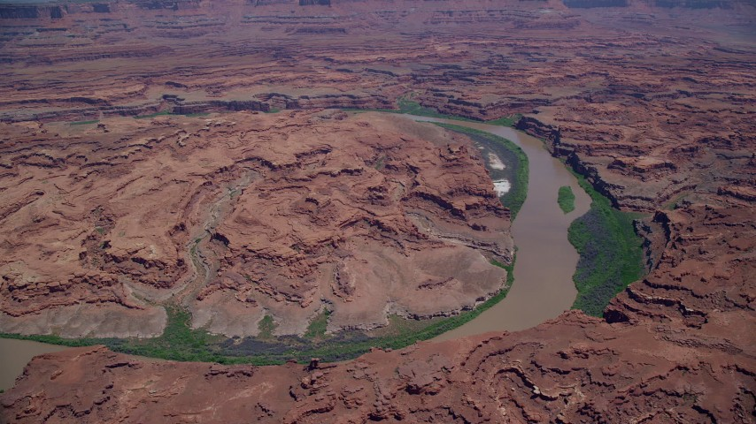 6K stock footage aerial video of flying by Colorado River through Meander Canyon, Canyonlands National Park, Utah Aerial Stock Footage | AX136_258