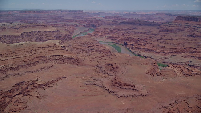 Tilt to buttes, Colorado River, Meander Canyon, Canyonlands National Park, Utah Aerial Stock Footage | AX136_259
