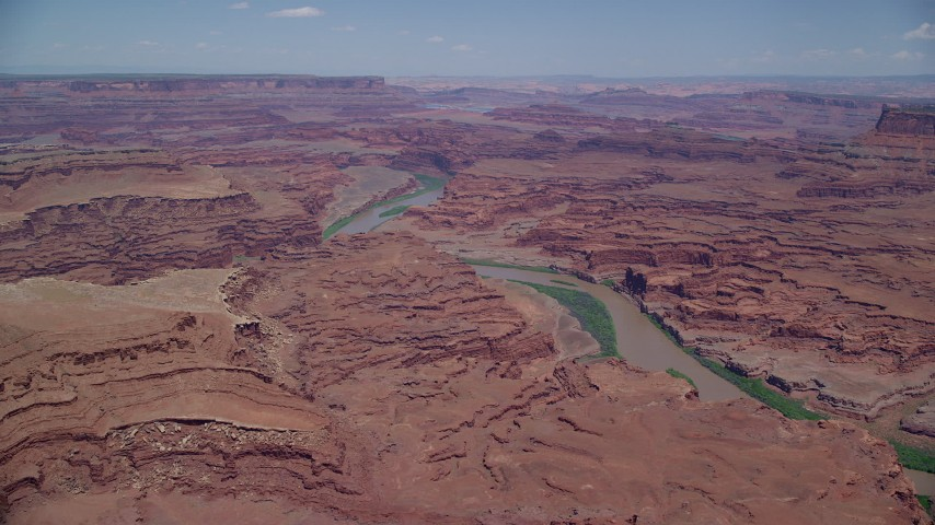 Approaching Colorado River, Meander Canyon, Canyonlands National Park, Utah Aerial Stock Footage | AX136_260