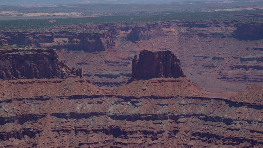 6K stock footage aerial video of flying by desert butte atop canyon wall, Canyonlands National Park, Utah Aerial Stock Footage   AX136_263