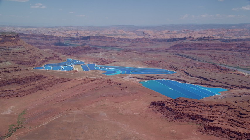6K stock footage aerial video of approaching potash ponds and desert valley, Moab, Utah Aerial Stock Footage | AX136_268