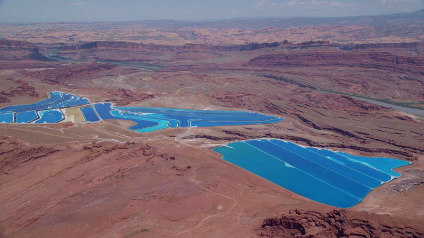 6K stock footage aerial video of flying toward potash ponds in a desert valley, Moab, Utah Aerial Stock Footage | AX136_269