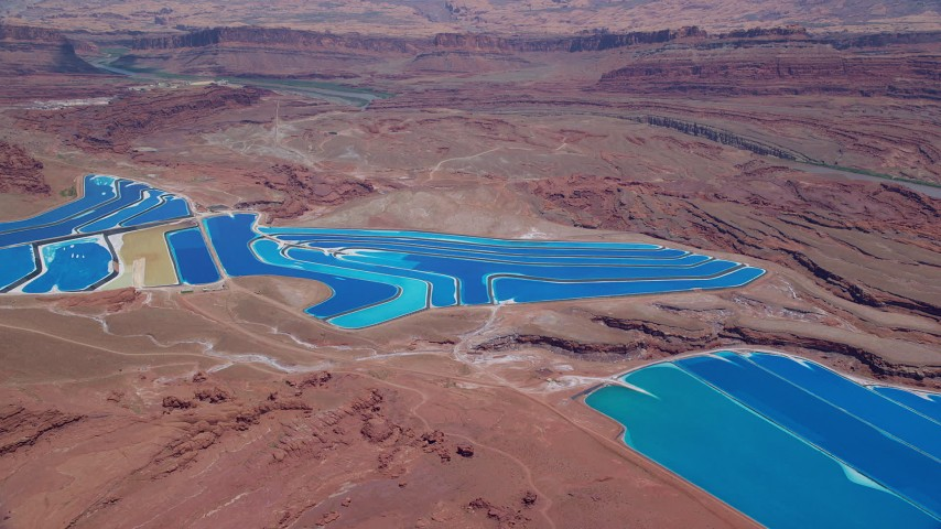 6K stock footage aerial video of potash ponds in a desert valley, Moab, Utah Aerial Stock Footage | AX136_270