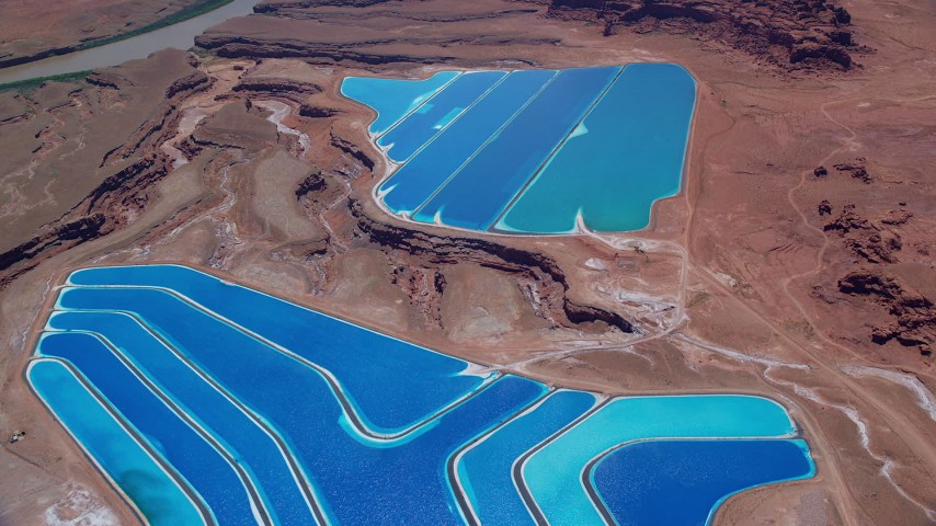 6K stock footage aerial video of flying away from potash ponds, Moab, Utah Aerial Stock Footage | AX136_273