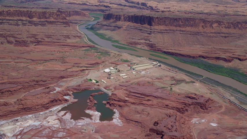 6K stock footage aerial video of approaching Intrepid Potash plant by Colorado River, Moab, Utah Aerial Stock Footage | AX136_275