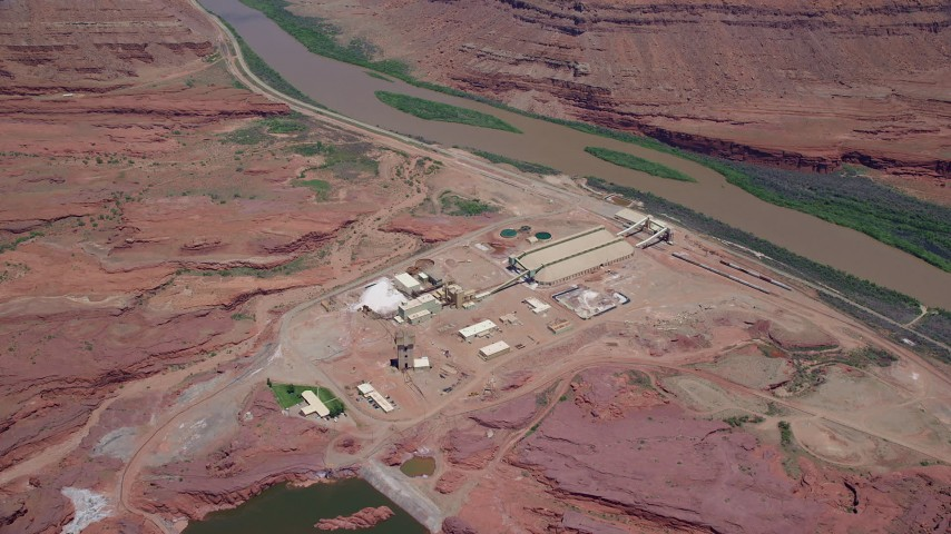 6K stock footage aerial video of approaching and tilting to the Intrepid Potash plant by the Colorado River, Moab, Utah Aerial Stock Footage | AX136_276