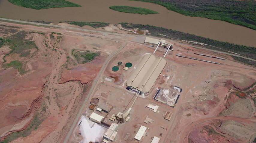 Bird's eye view flying over Intrepid Potash, Colorado River, Moab, Utah Aerial Stock Footage | AX136_277
