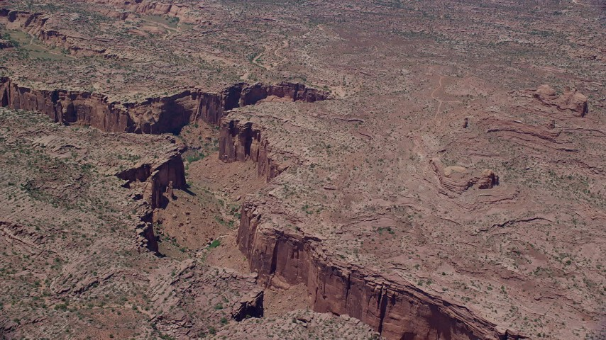 6K stock footage aerial video of flying by a deep desert canyon, Moab, Utah Aerial Stock Footage | AX136_281