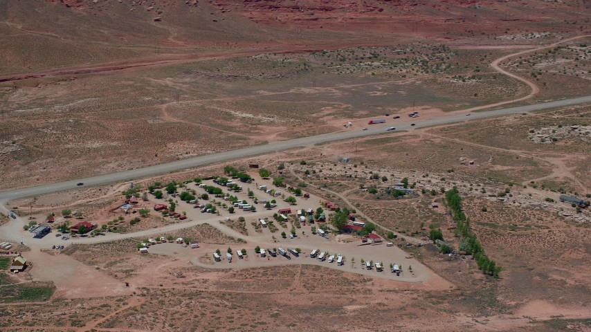 6K stock footage aerial video of flying by Archview RV & Resort Campground by Highway 191, Moab, Utah Aerial Stock Footage | AX136_288