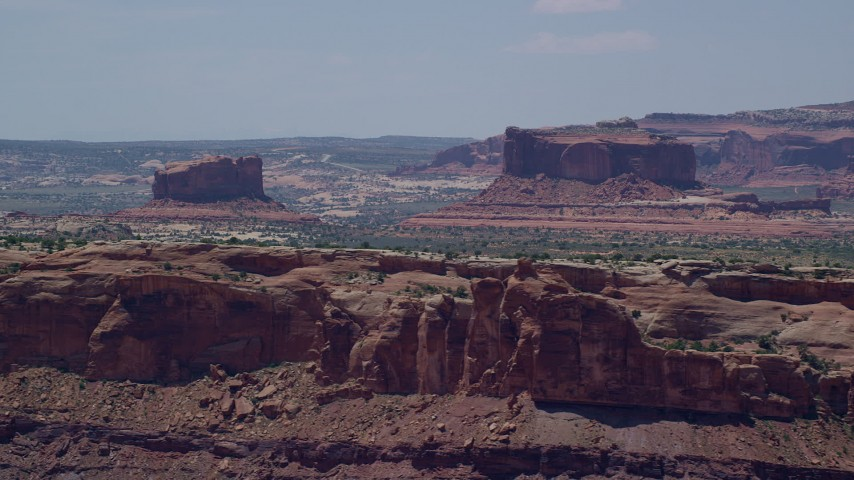 6K stock footage aerial video of flying by Monitor Butte and Merrimac Butte, Moab, Utah Aerial Stock Footage | AX136_289