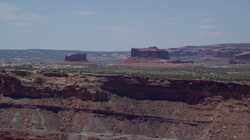6K stock footage aerial video of passing by Monitor Butte and Merrimac Butte, Moab, Utah Aerial Stock Footage | AX136_290
